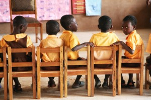 Children in a classroom on chairs